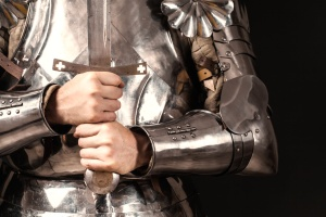 knight wearing armor and holding two-handed sword